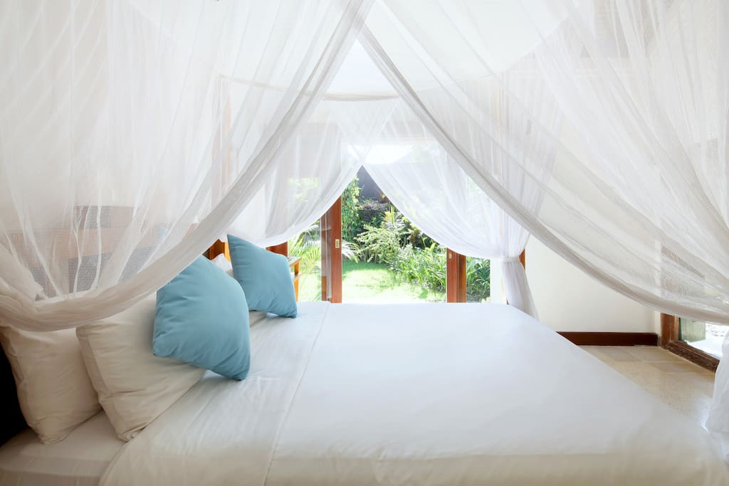Bedroom romance - four poster teak queensize bed with soft canopy netting, 5 star mattress and pillows