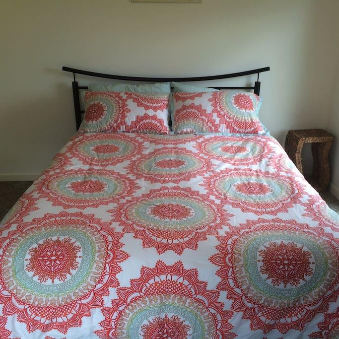 Queen sized bed in bedroom 1.