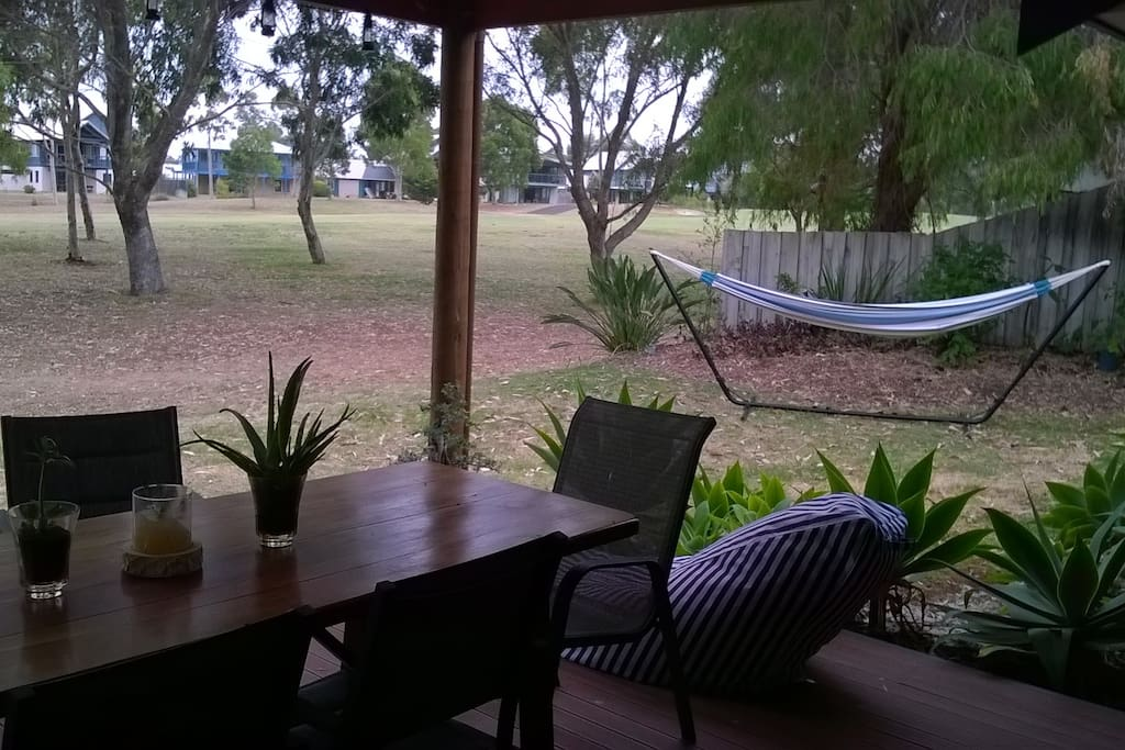 Relax in our outdoor area in the hammock or on a bean bag chair overlooking the golf course