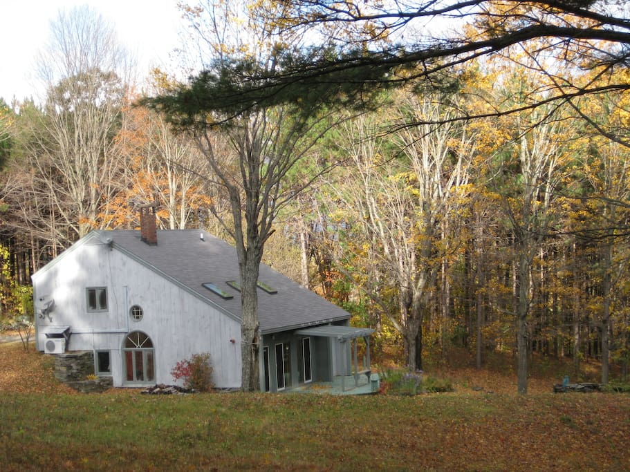The house seen from the hill during fall.