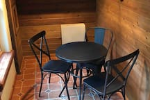 Bistro table for 3 in sunny solarium kitchenette, pantry storage on shelving in south wall . In addition to central heating small propane heater in solarium for your comfort on cold days.