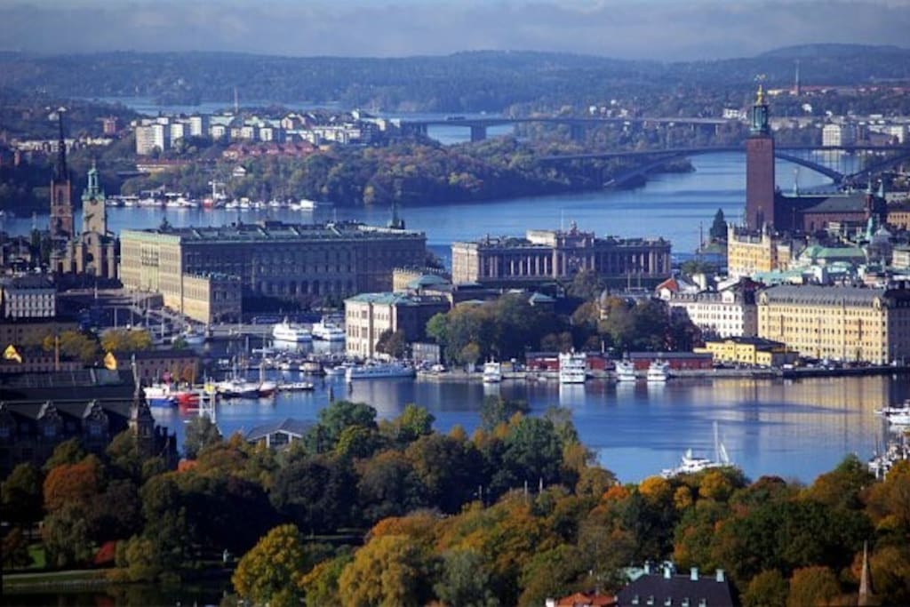 Old Town with the Royal Castle to the left. Helgeandsholmen with the Parliament building a little to the right. To the right Stockholm City Hall and buildings for the governement and Prime minister.