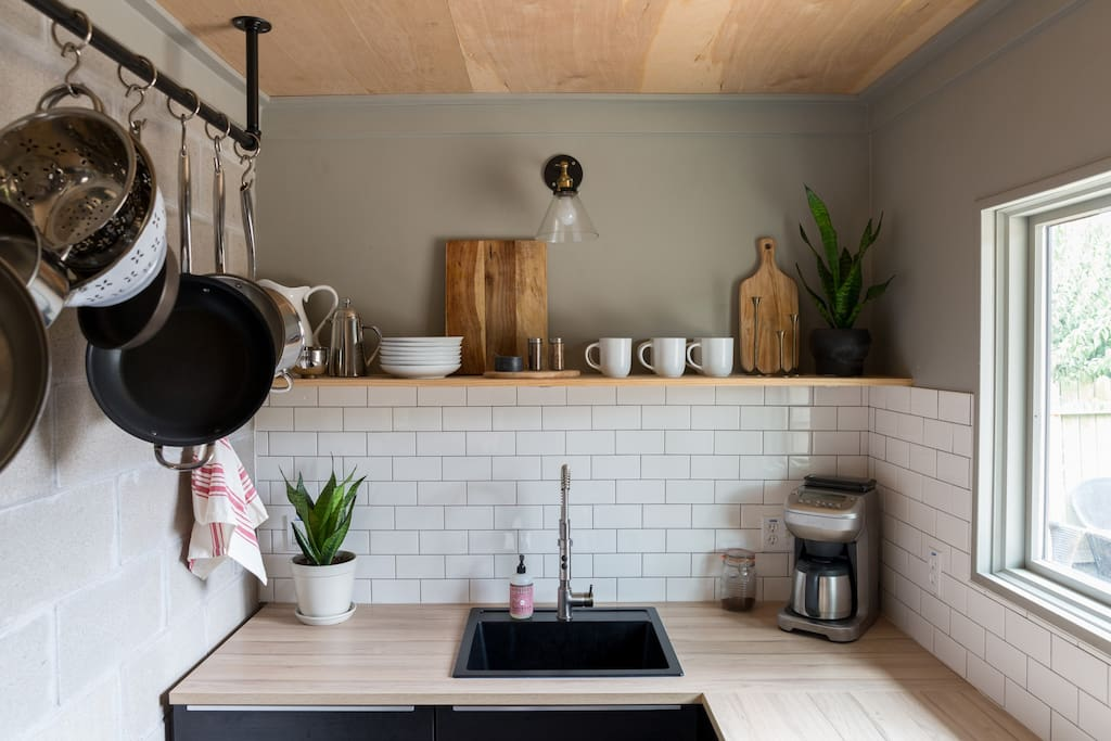 Tiny kitchen - fully stocked for all your cooking needs.