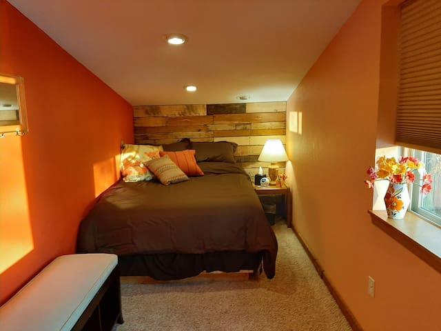 Sunrise bedroom.  Dimmable light remote, fan, blackout blind & alarm clock with bluetooth/white noise options.