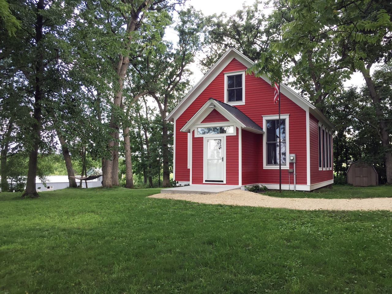 1912 original school house on wooded one acre lot.