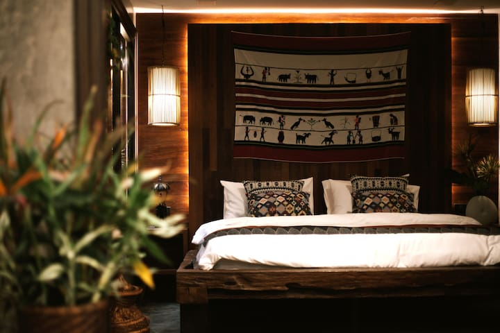 """Bed 1 :  """" Chareon Krung Room"""" king bed with small garden."""
