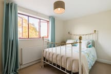 Bedroom 2 with views across front garden and countryside. Hair dryer. Large built in wardrobes.