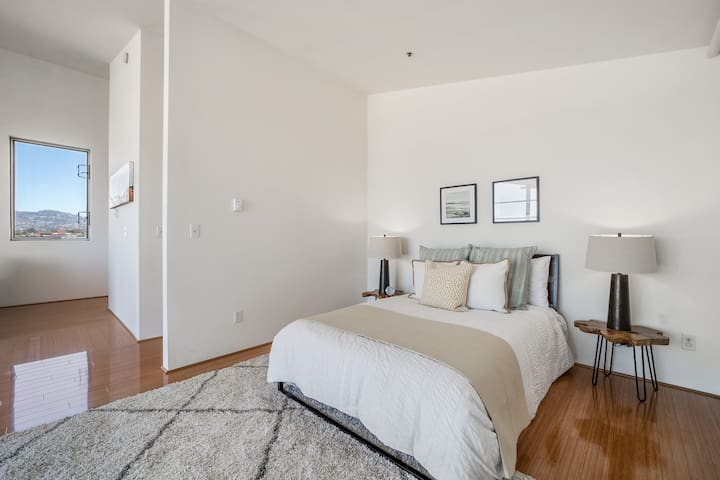 Bedroom has two story views with floor to ceiling windows