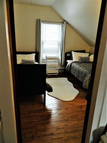 Bedroom with two twin beds - view looking in from bedroom with full bed