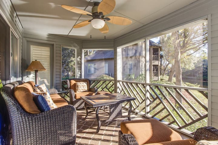 Lagoon view first floor villa with screened in porch, near the beach and golf!