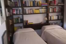 stanza libreria letti singoli
