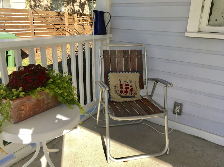 Enjoy a cup of tea or a cold beverage whilst sitting on your own, private front porch, whilst watching the comings and goings of this quiet neighborhood.