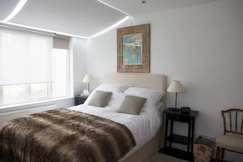 Charming double bed in family home.