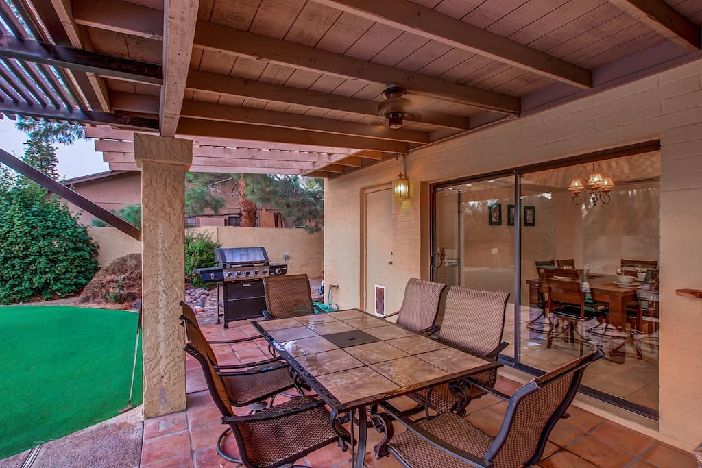 Outdoor Dining Table and Gas Grill.