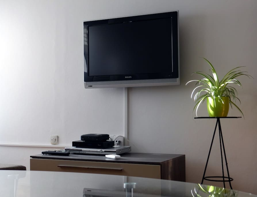 Entertainment center with LCD TV, cable TV, DVD player and WiFi Internet.