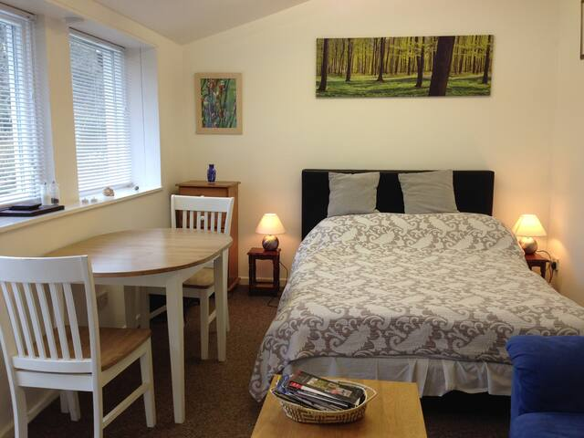 Double bed and table for two
