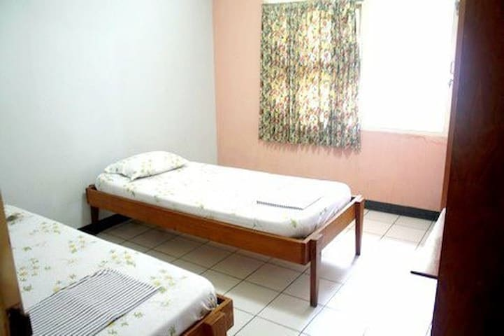 A room with twin bed