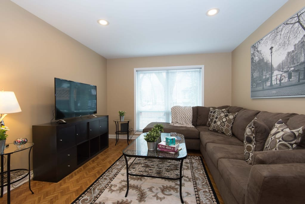 "The living room features a 50"" TV and a full, sofa sleeper."