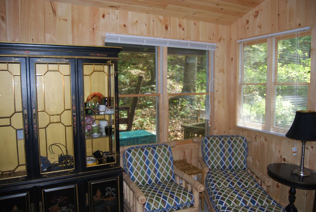 Part of the Eco Cabin's Living Area, lots of windows!