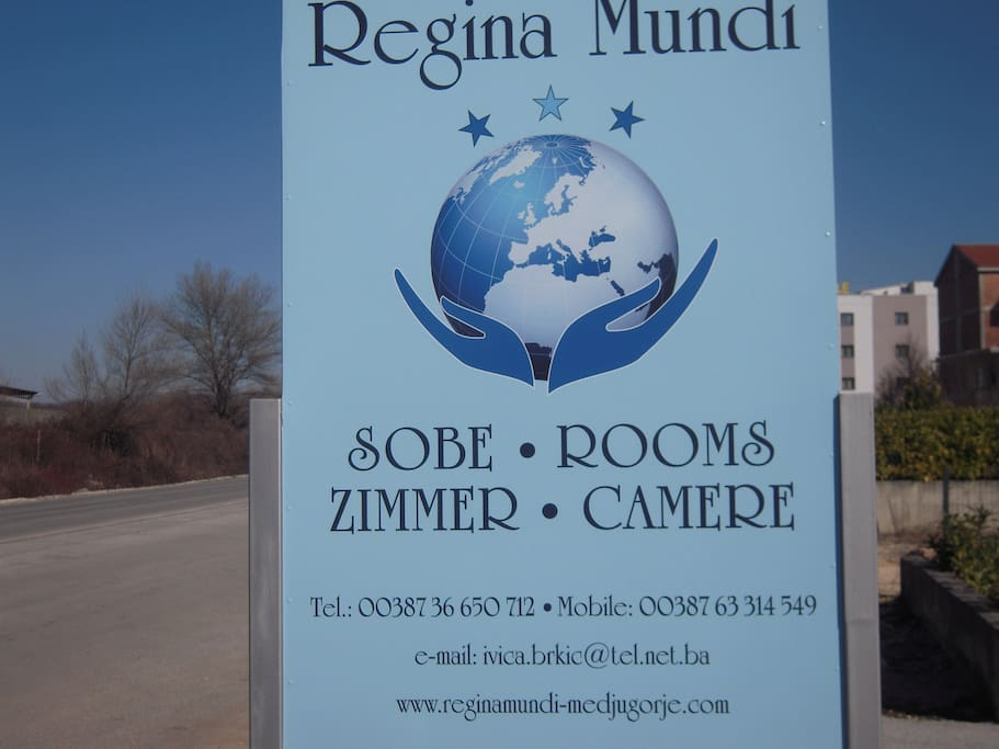 The sign with Regina Mundi logo