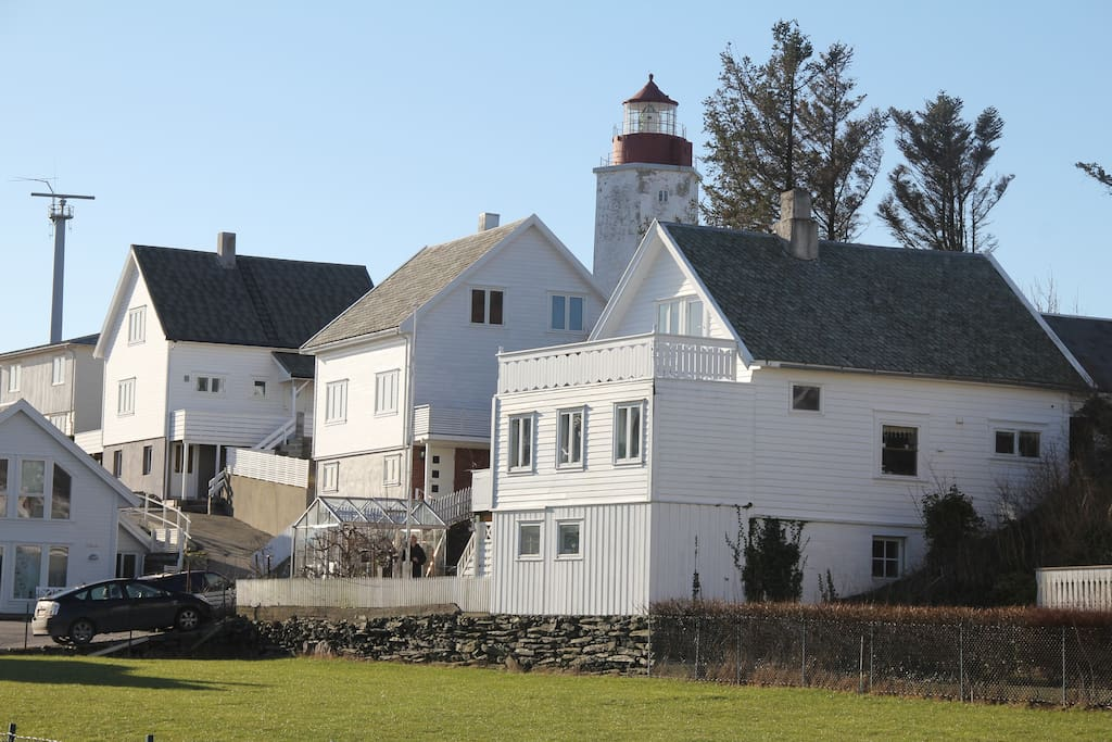 The house is close  to the lighthouse