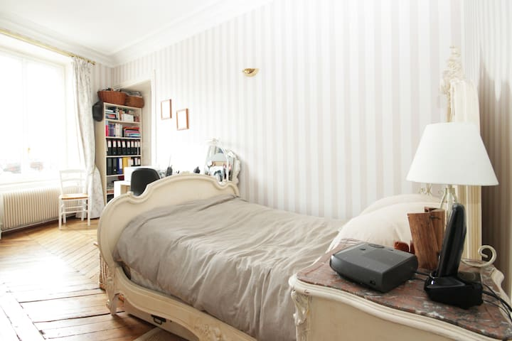 Charming bedroom, in a nice typical Parisian flat