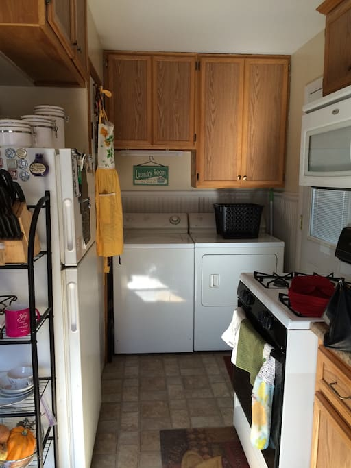 More of the kitchen where the laundry facilities are located. Outside door leads to back porch and yard.