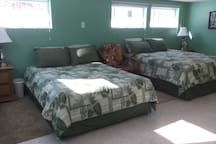 Very large bedroom with 2 queen size beds.