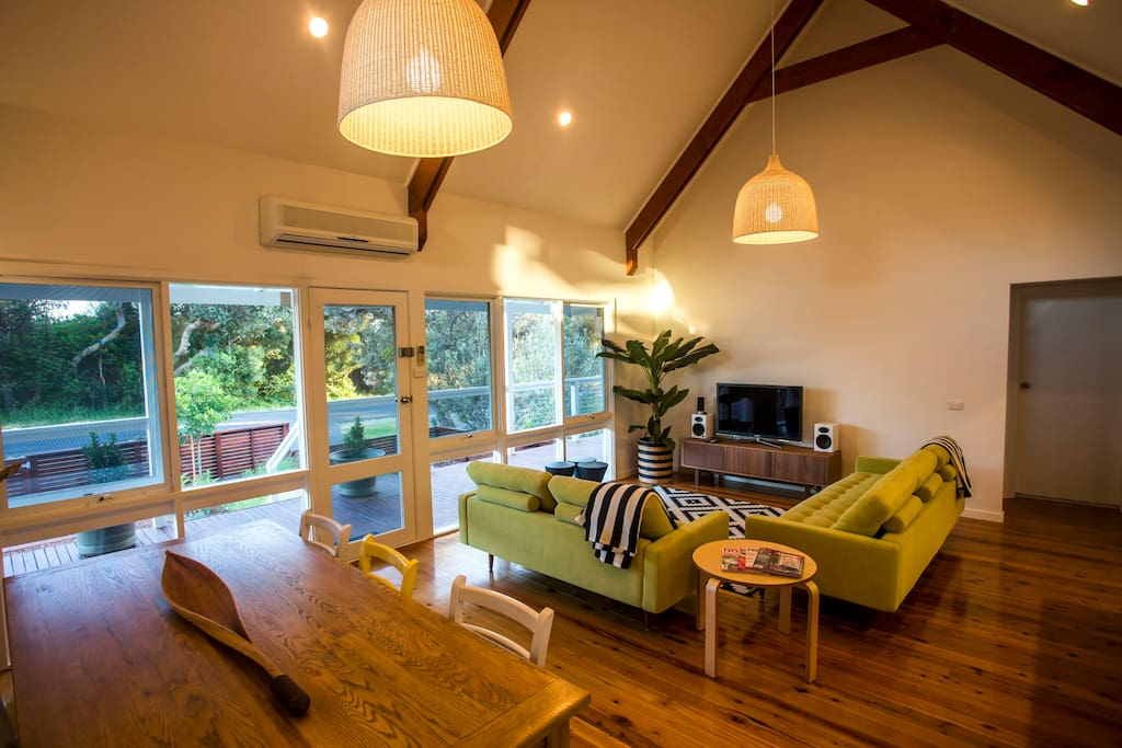 Bright and airy, open plan lounge, dining and kitchen.