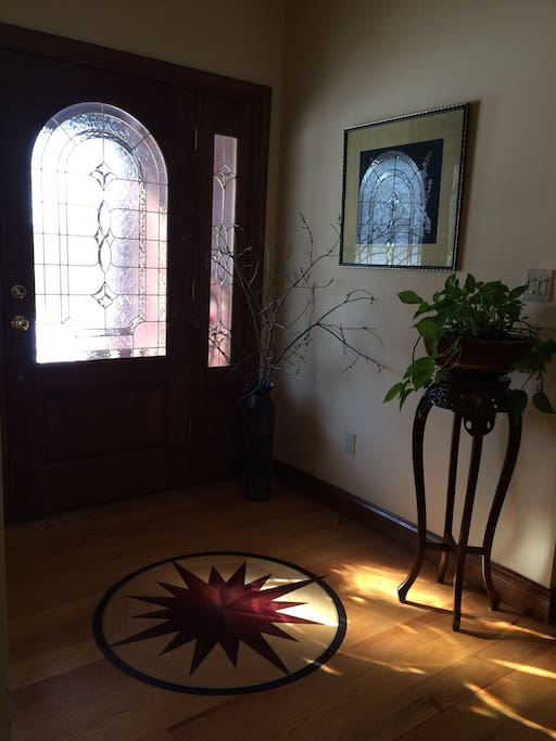 Sun-drenched foyer with inlaid wooden compass pointing you towards your destination.