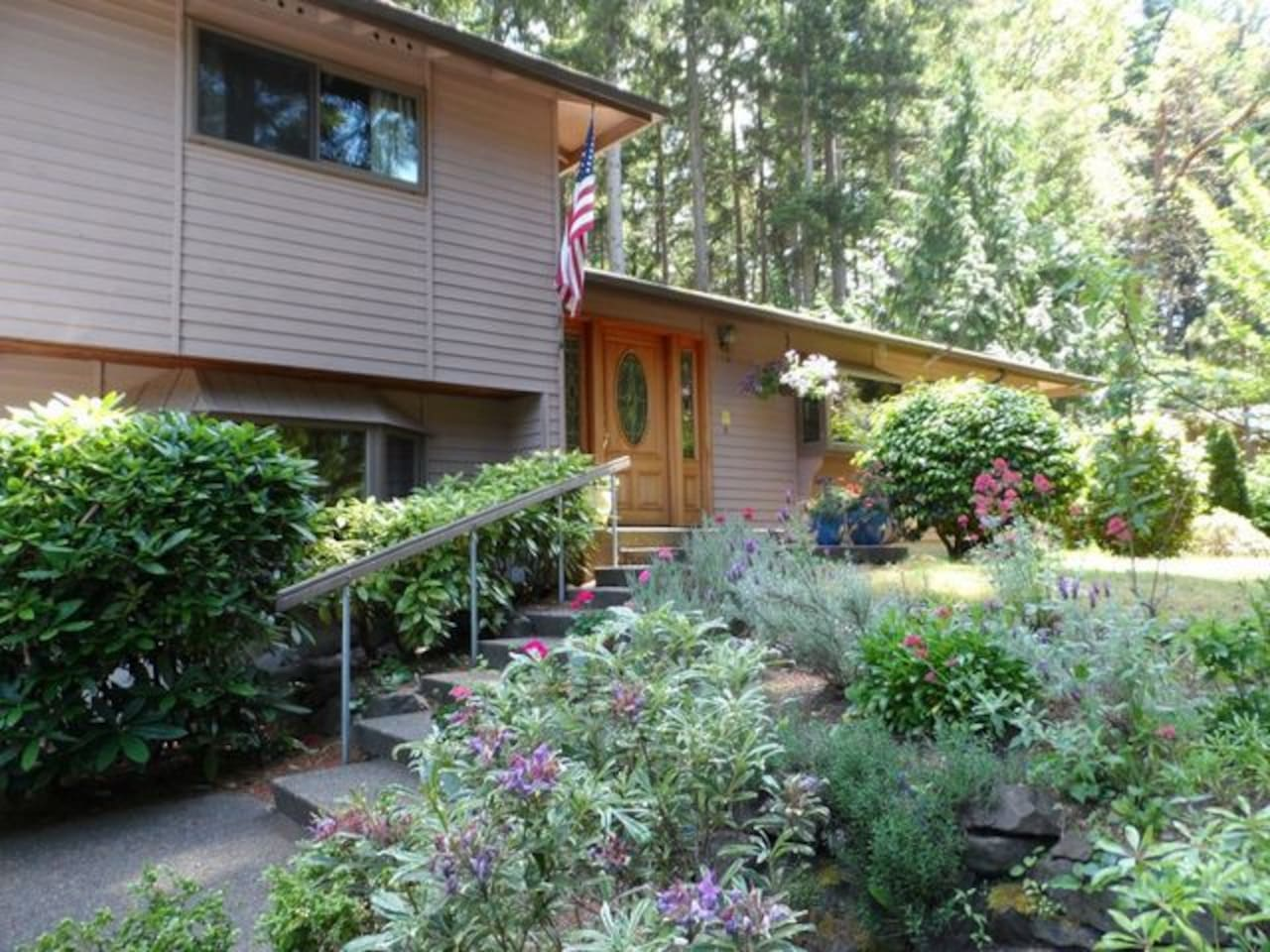 View of the front of the house when the garden is in full bloom.