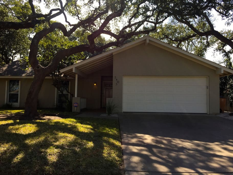Great curb appeal! Lots of mature live oaks.