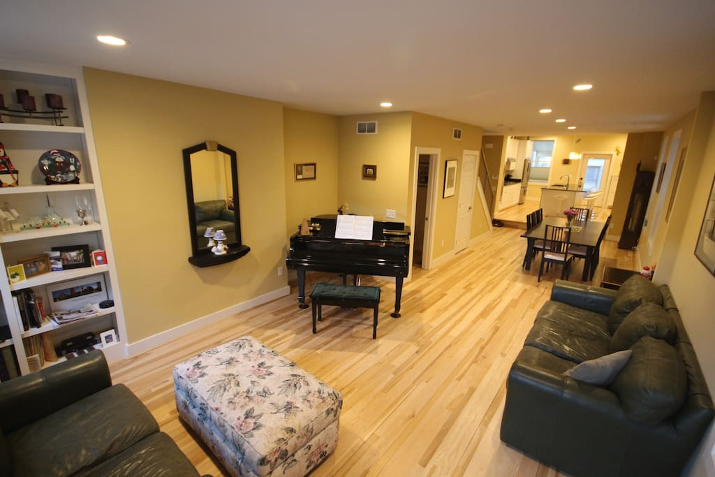 First floor living and dining areas have beautiful wood floors and natural light.