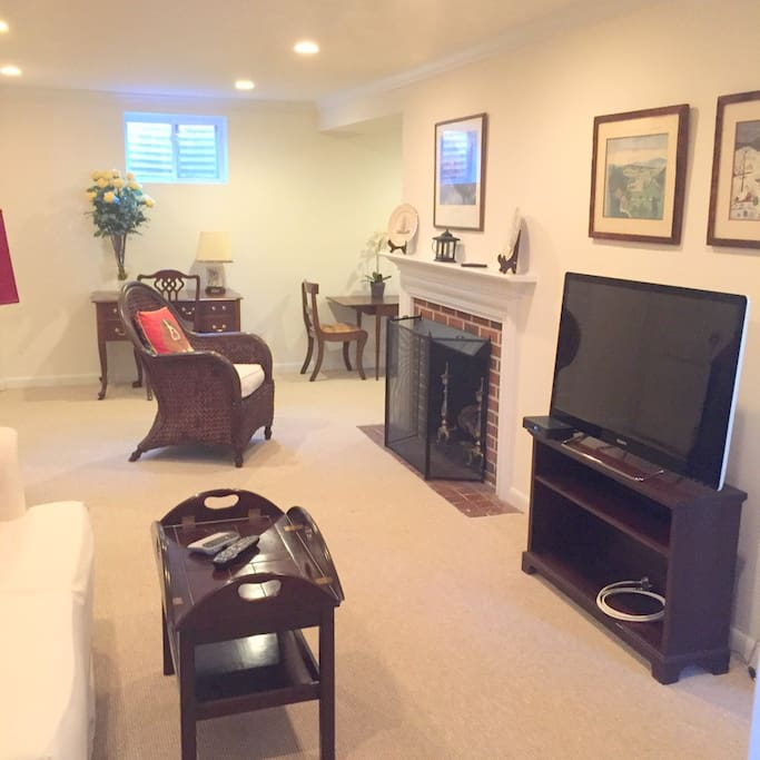 Living room with gas fireplace and 42 inch flat screen TV
