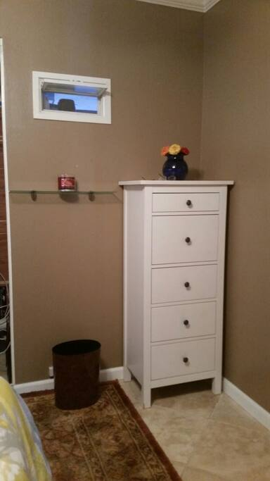 Two dressers for storing clothes.