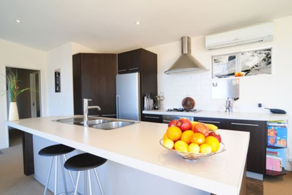 Open living and dining. All day sun. Stunning views to pool and Coronet Peak