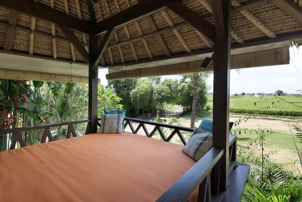 Lazy daze on the lazy daybed , front row seats for our UNESCO listed rice fields and stunning tropical sunsets .