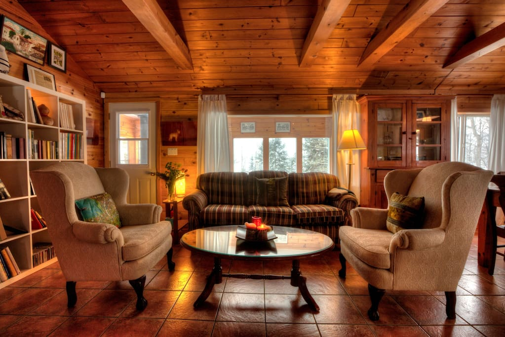 Living room overlooking the screened porch and nature