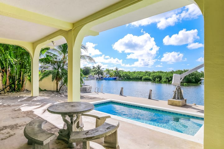 Entertaining waterfront home with private pool, central AC, and water views!