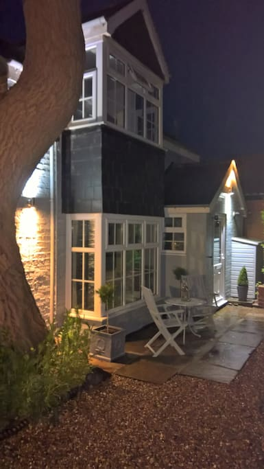The cottage at night.