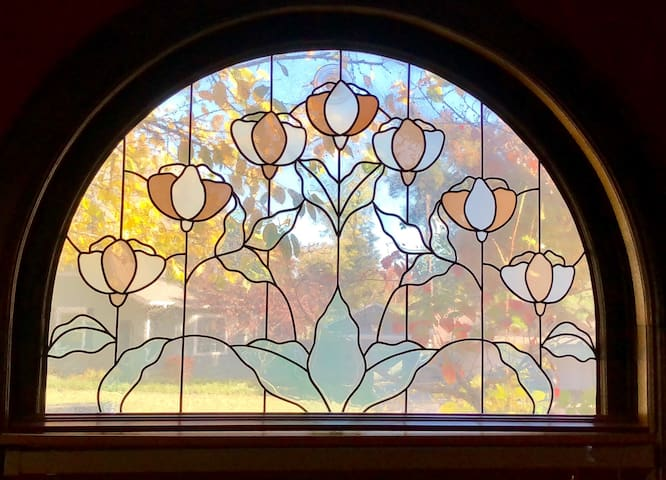 """Tree of life"" stained-glass window view from the dining room (where morning coffee/tea and light breakfast are served)."