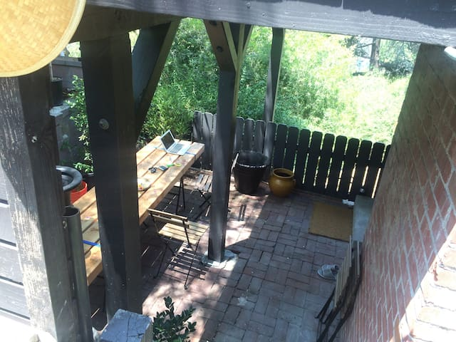 Patio with long table for work, eat..