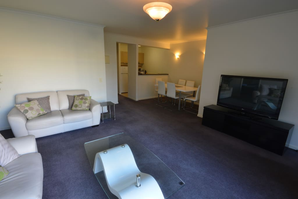The lounge features a comfortable 3 seat and 2 seat leather lounge suite and leads to a balcony over looking the gardens