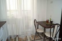 На кухне: стол и 2 стула.