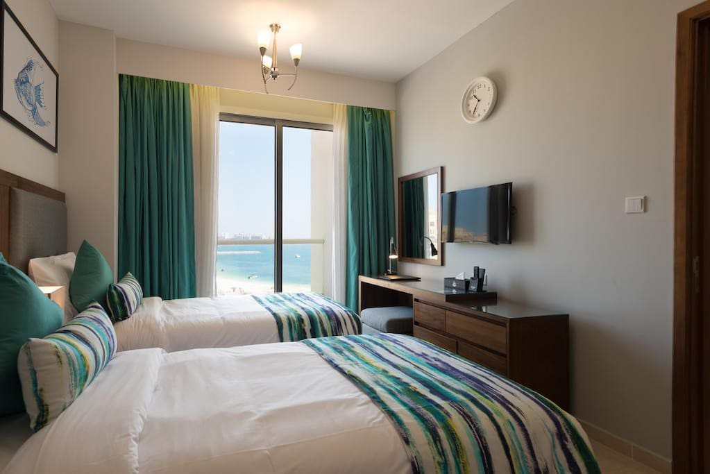 Comfy twin bed with beach view