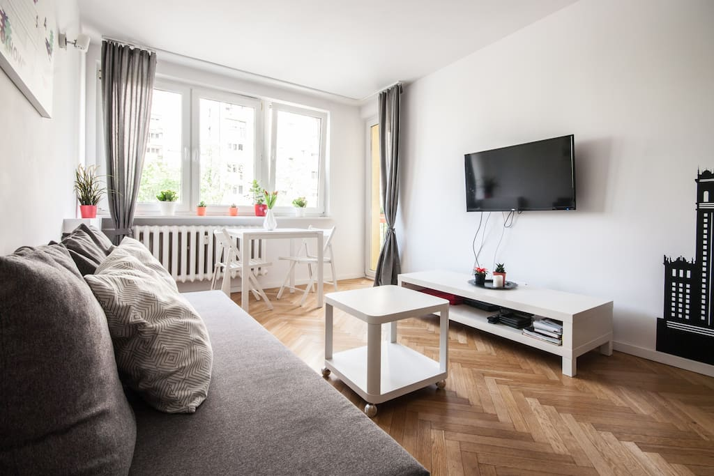 In the living room you can relax on a comfortable sofa, watch TV or read some books about Warsaw (included!).