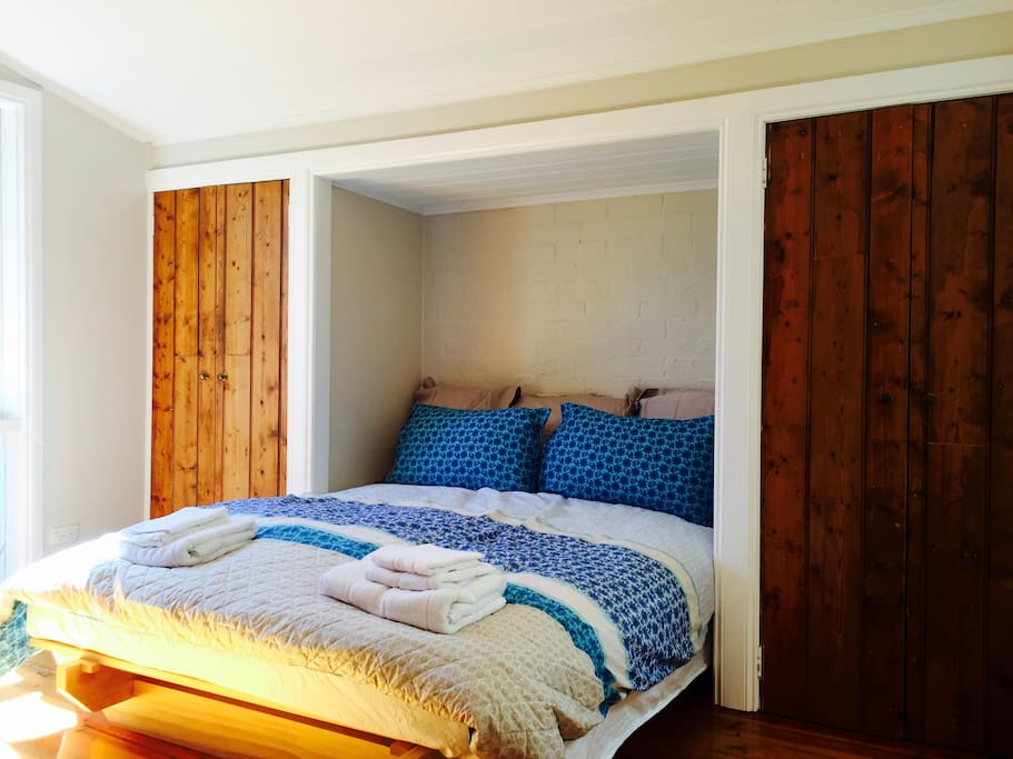 A super comfortable queen sized bed with handmade wooden closets. There is a beautiful old brick OFP for cosy nights in.