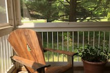 Comfortable Adirondacks in the screened-in porch.