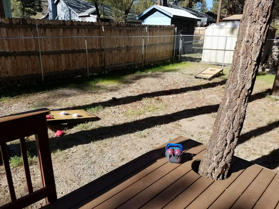 cornhole boards and bocce ball for a fun family BBQ