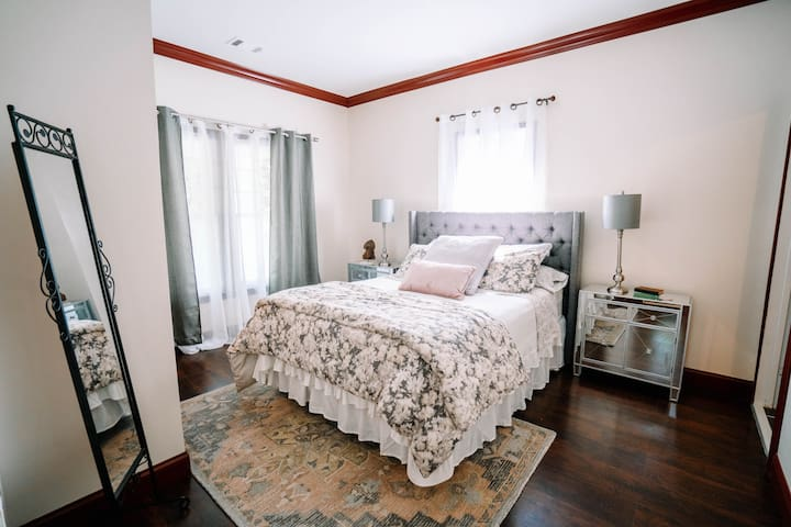 Master bedroom with the coziest bed and master bath.